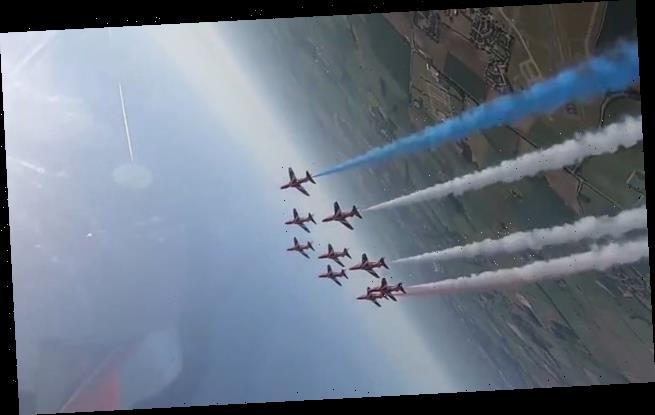 RAF's elite Red Arrows display team perform loop manoeuvre