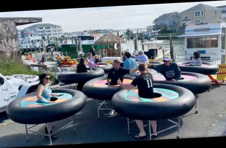 Bar introduces giant rubber rings on wheels to keep drinkers socially distanced when they reopen after lockdown – The Sun