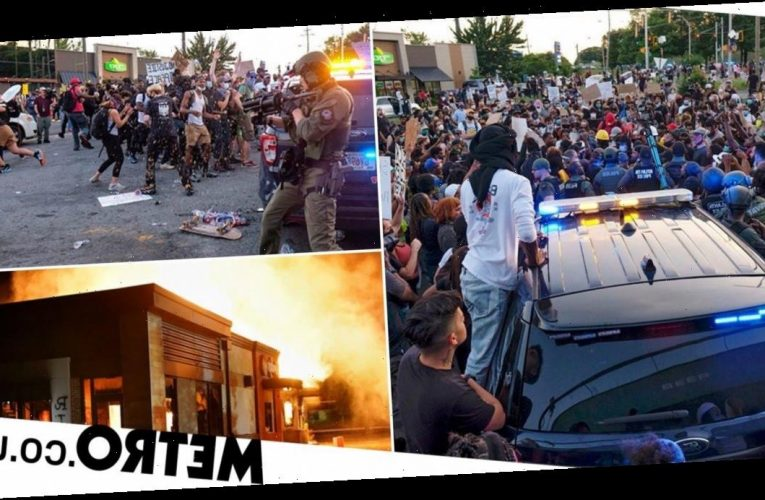 Protesters set fire to restaurant where black driver was shot dead by white cops