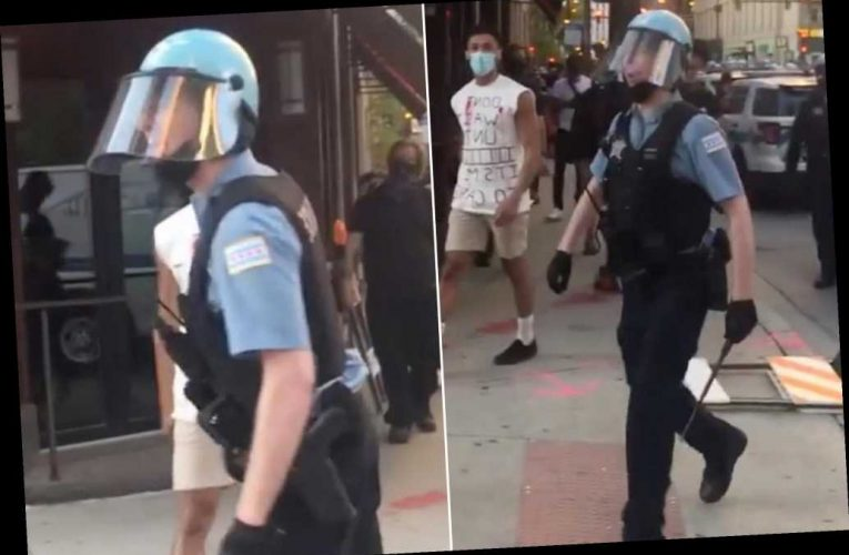 Chicago cop caught yelling homophobic slur at protester, video shows
