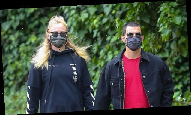Sophie Turner Shows Off Growing Baby Bump In Skintight Black Leggings While Out With Husband Joe — See Pics