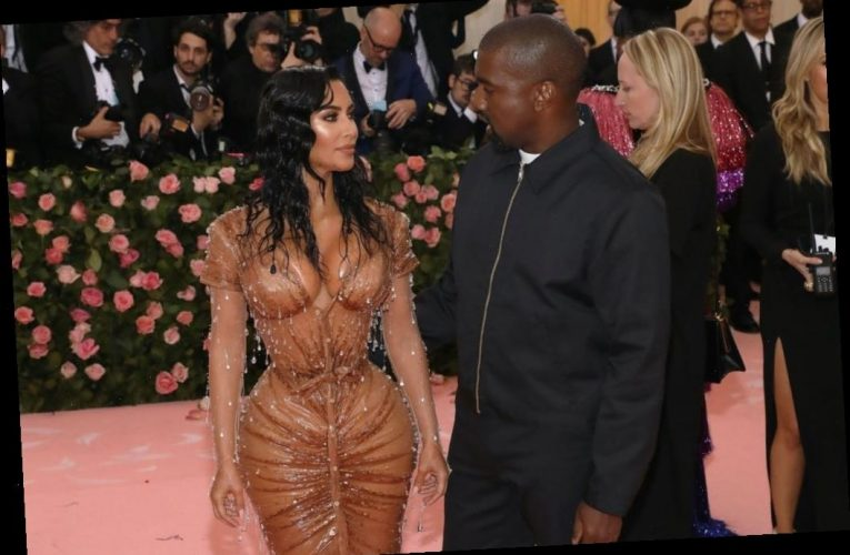 Kim Kardashian West Shows Off Tiny Waist in Throwback Corset Video and Fans Are Very Worried