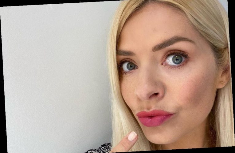 Holly Willoughby pouts as she begs followers to help her decide which lipstick to wear on This Morning