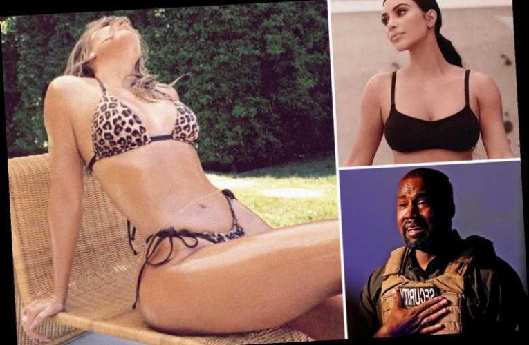 Khloe Kardashian flaunts flat stomach in a leopard-print bikini as sister Kim copes with Kanye West's breakdown