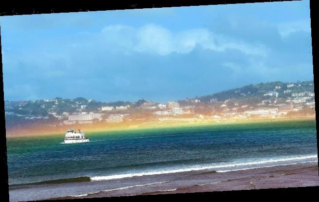 Rare flat rainbow beams across sea in Devon