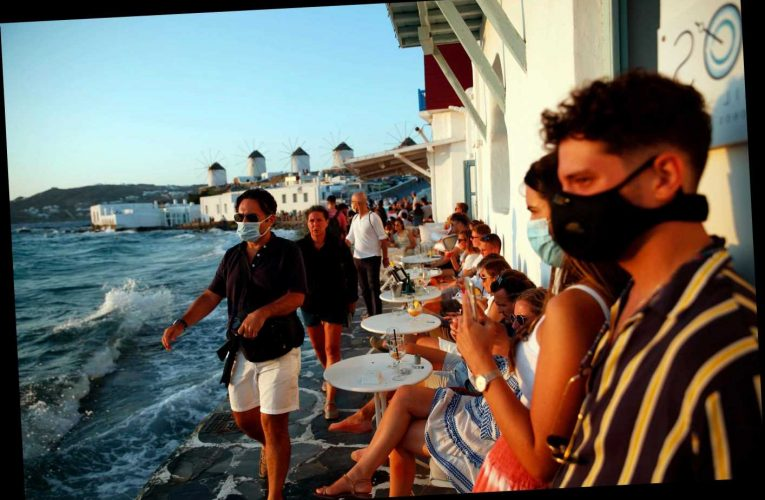 Furious Greek bar owners fined for opening after curfew as lockdown rules hit country