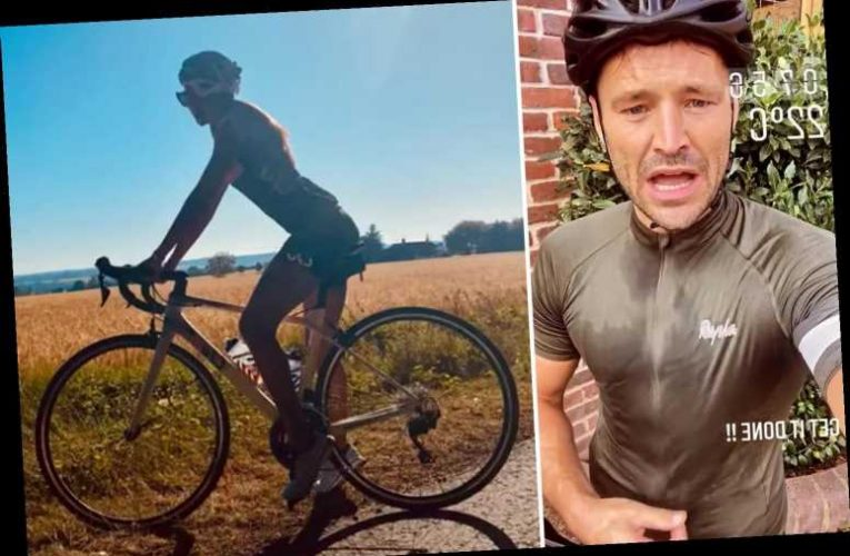 Mark Wright and Michelle Keegan work up a sweat as they go on a bike ride during 34 degree heatwave