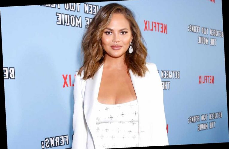 Chrissy Teigen Reveals She Was Pregnant During Breast Implant Removal Surgery but Didn't Know It