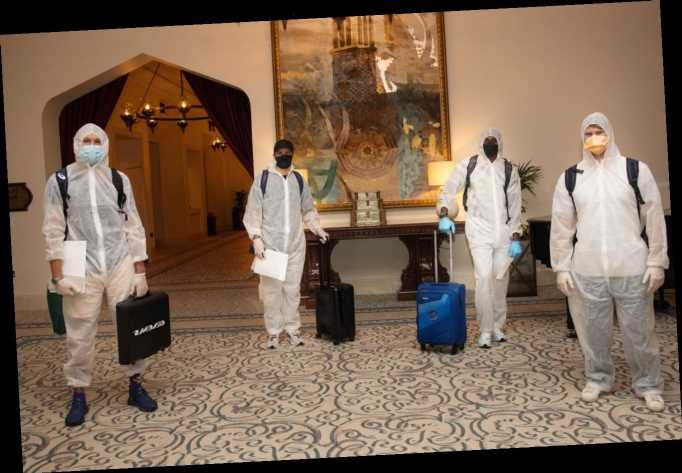 IPL stars Jofra Archer, Steve Smith and Tom Curran in hazmat suits as England and Aussie aces fly into UAE