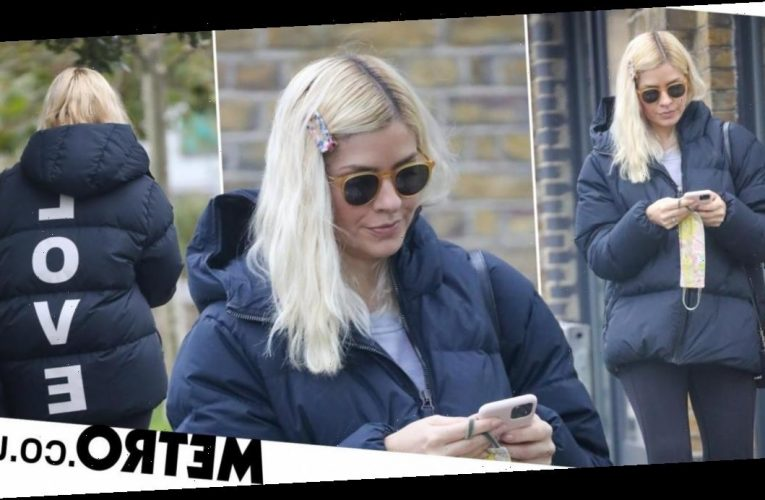 Holly Willoughby wears her heart on her coat as she wraps up for London outing