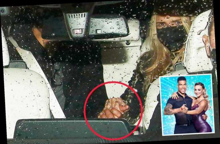 Nadine Coyle and Jason Bell hold hands as they depart Strictly Come Dancing studios after epic first live show