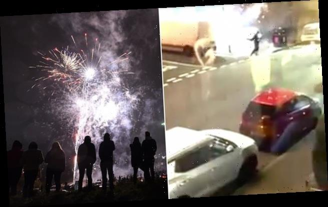 Terrifying moment yobs fire rockets at police on Bonfire Night