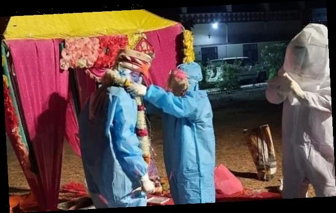 Indian couple marry in PPE gear after bride tests positive for Covid