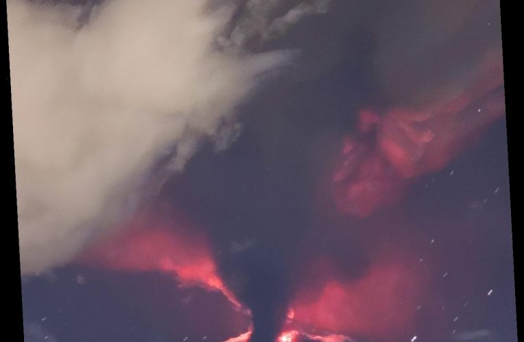 Mount Etna erupts in Sicily sending plumes of ash and spewing lava into air