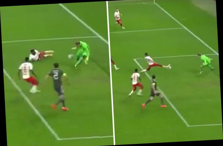 Watch the unreal injury-time wonder save that denied Man Utd an equaliser as RB Leipzig keeper Gulacsi stops own-goal