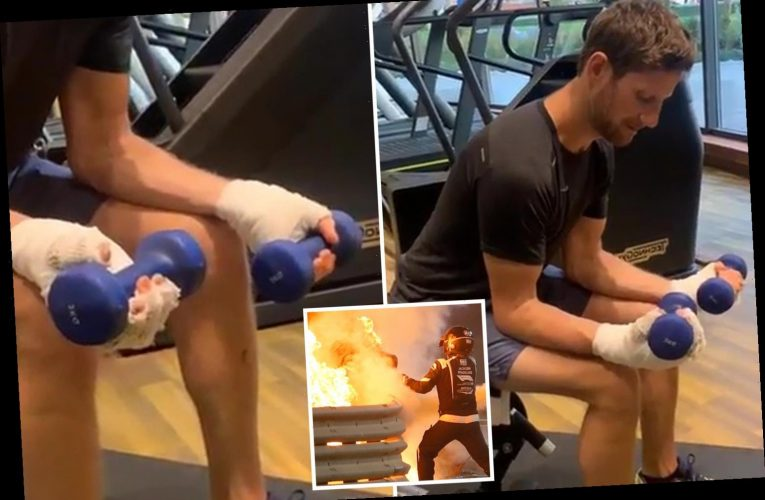 Watch brave Romain Grosjean hit the weights just SIX DAYS after crash which left him in hospital with burns to his hands