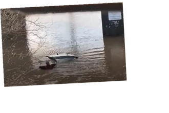 Dramatic moment couple rescued from submerged car after being trapped underwater for two hours in floods