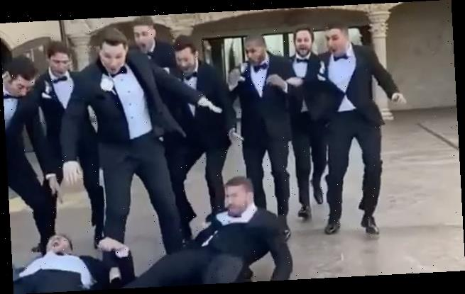 Groomsmen fall on marble floor as they try to achieve perfect snap