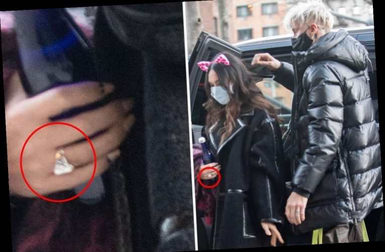 Megan Fox and Machine Gun Kelly spark engagement rumors after she's spotted wearing band on wedding ring finger