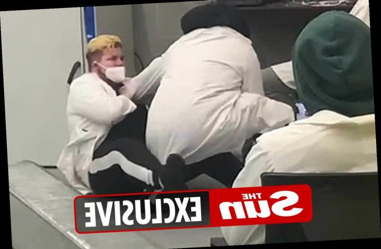 Workers at Covid testing centre shown 'fighting, boozing and snoozing' in shocking video