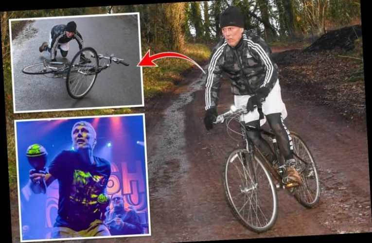Happy Mondays' Bez takes a tumble during seven-mile cycle ride as he bids to become YouTube fitness star