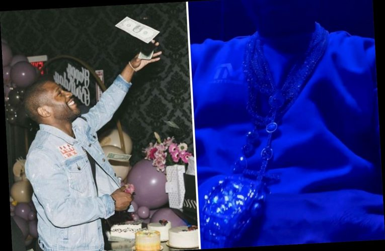 Mayweather shows off diamond jewels and watch and boasts 'I didn't retire from making money' ahead of Logan Paul fight