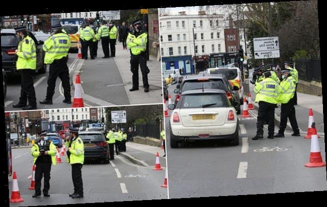 Police set up roadblock on west London's Putney Bridge