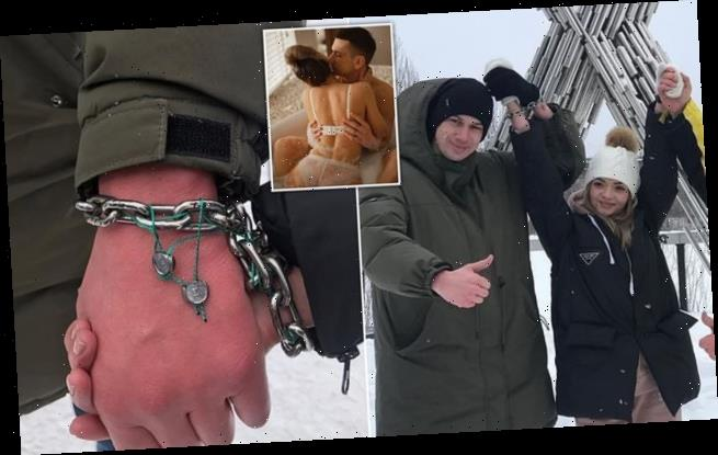 Ukrainian couple CHAIN themselves together for three months