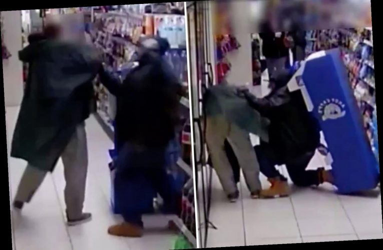 Shocking moment man is stabbed in the back after being attacked by couple in store yards from Times Square