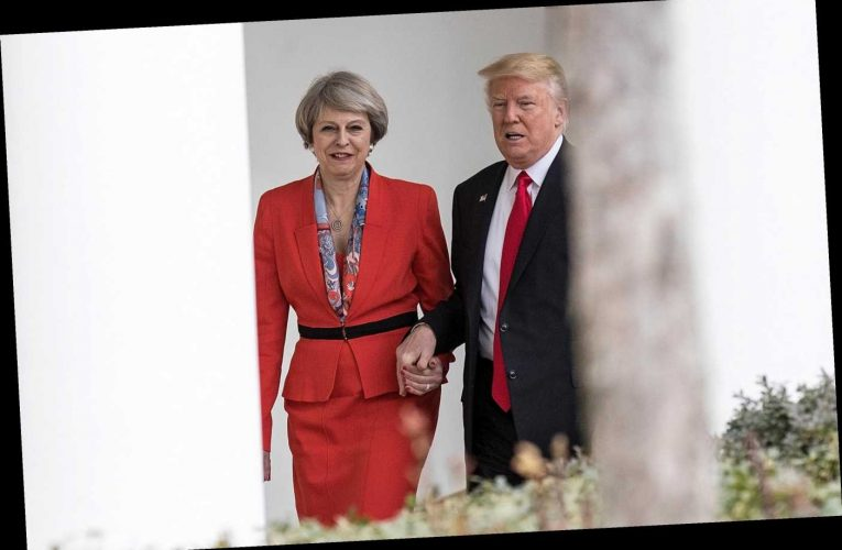 Worried Theresa May phoned her husband to say she was snapped holding hands with Donald Trump