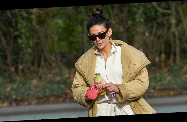 Michelle Keegan stuns in a chic padded coat and cream tracksuit as she takes pet pooches for a walk