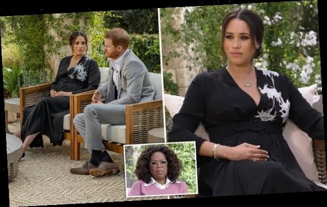 Meghan Markle cradles her baby bump in trailer for Oprah interview