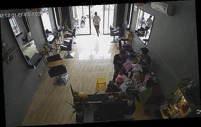 Hair salon worker runs straight into glass door