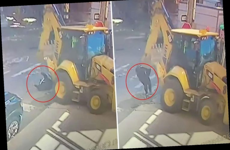 Shocking video shows digger crushing woman to death as she crosses the road looking at her phone