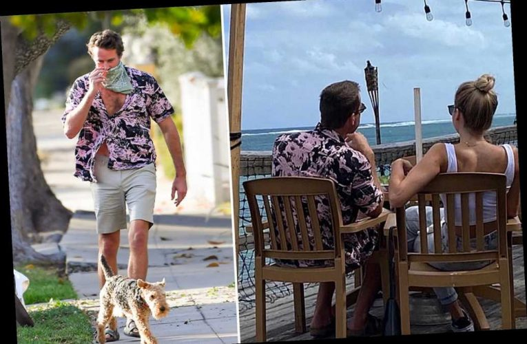 Armie Hammer dines out with mystery blonde in Cayman Islands