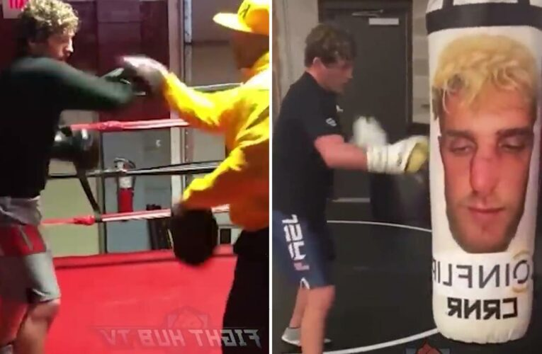 Ben Askren trolled for 'slow' training video as MMA star is taught how to punch before unleashing on Jake Paul heavy bag