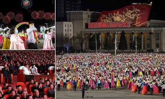 North Koreans don masks to celebrate birth of country's founder
