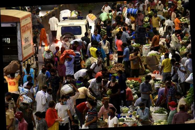 India Covid cases surge past 100,000 a day as 'double mutant' spreads amid 'packed crowds with no masks'