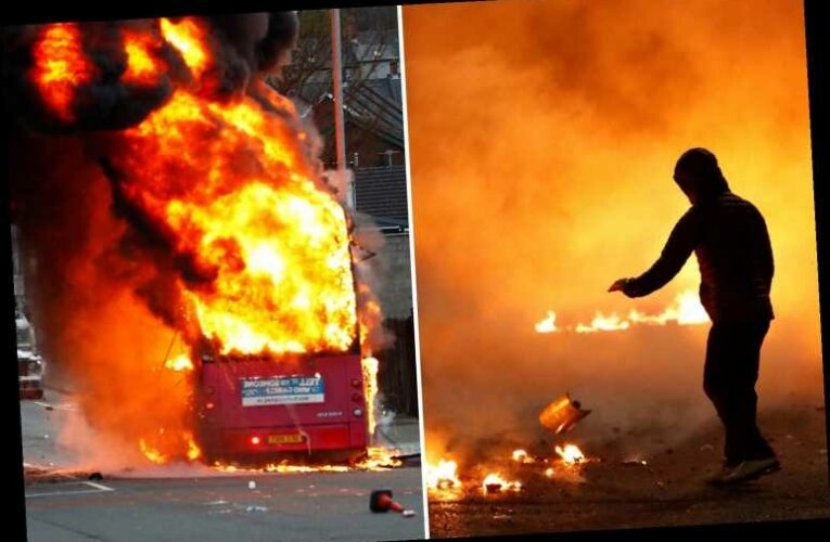 Bus firebombed and police attacked as Boris Johnson condemns latest night of violence in Belfast