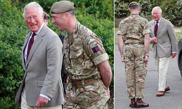 Prince Charles, 72,visits Combermere Barracks in Windsor, Berkshire