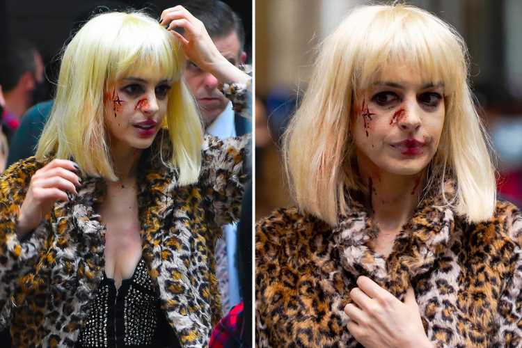 Anne Hathaway is caked in fake blood and dons blonde wig to film accident scene