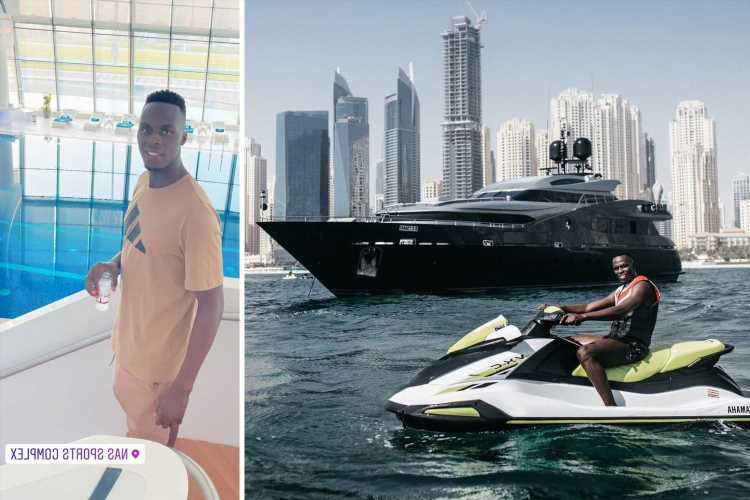 Chelsea star Edouard Mendy rides jet ski in front of yacht in Dubai as he relaxes during summer holiday