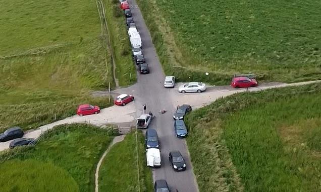 Drone shows cars lining road after hundreds attend illegal rave
