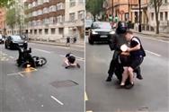 Moment drunk Scotland fan is knocked down by motorbike after walking straight into traffic as Tartan Army hit London