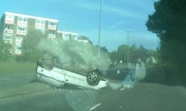 Terrifying moment van swerves across road and flips onto its roof