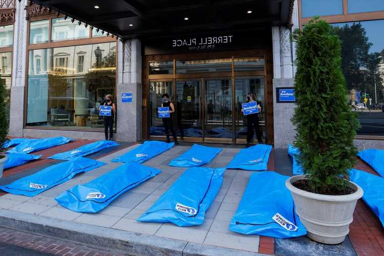 Bodybags lined up in front of Facebook HQ in 'disinfo kills' protest urging tech giant to stop spread of vaccine lies