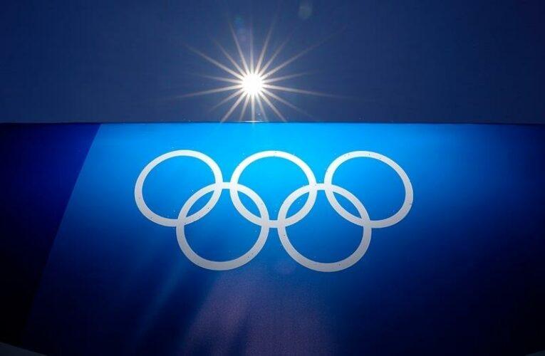 Canada's Summer McIntosh, 14, puts Olympics on notice with record swim