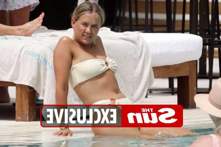 Molly-Mae Hague relaxes by the pool in a thong bikini with no make-up in party island Ibiza