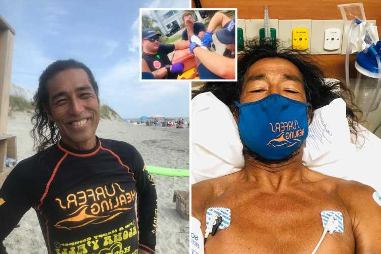 Shark attacks surf instructor giving lessons to kids which missed children by INCHES