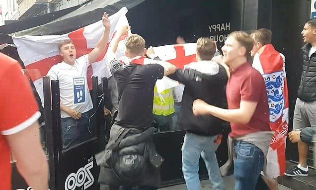 Shocking moment England fans storm a London bar and set off a flare